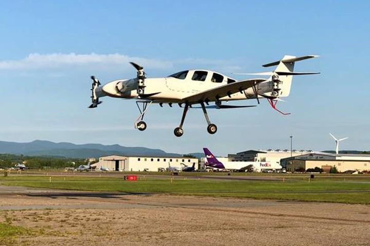 electric airplane in flight VTP