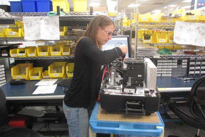Woman working with tools on machinery BioTek VTP