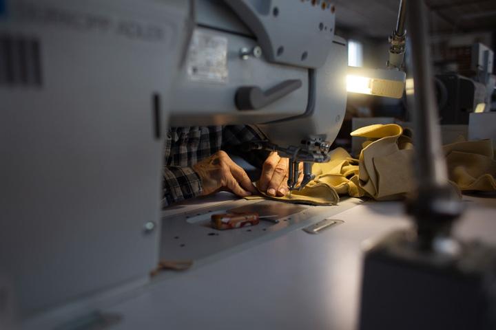 man at a sewing machine VTP