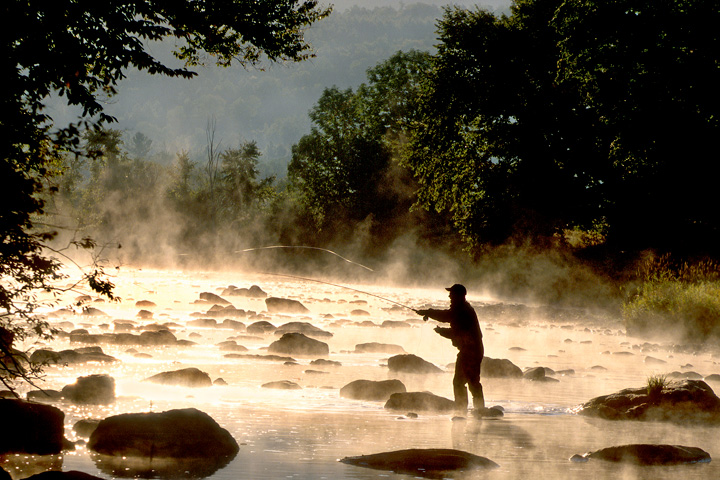 Man fly fishing in a Vermont river
